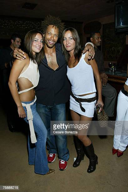 Gary Dourdan with twins Nikki Collins and Teena Collins at AAAW Party