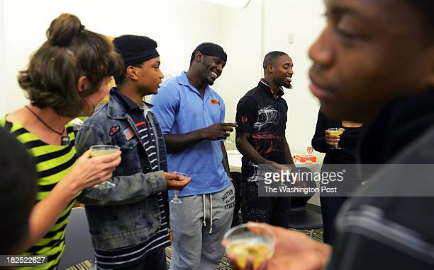 Gary Durant 3rd from L speaks to high school youth during a grape juice toast as part of Free Minds an atrisk youth outreach program at Anacostia...