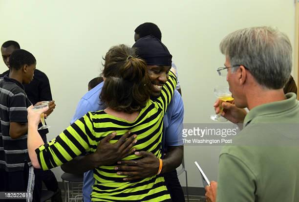 Gary Durant gets a hug from Tara Libert Tara Libert Cofounder and Executive Director of Free Minds Book Club Writing Workshop an atrisk youth...