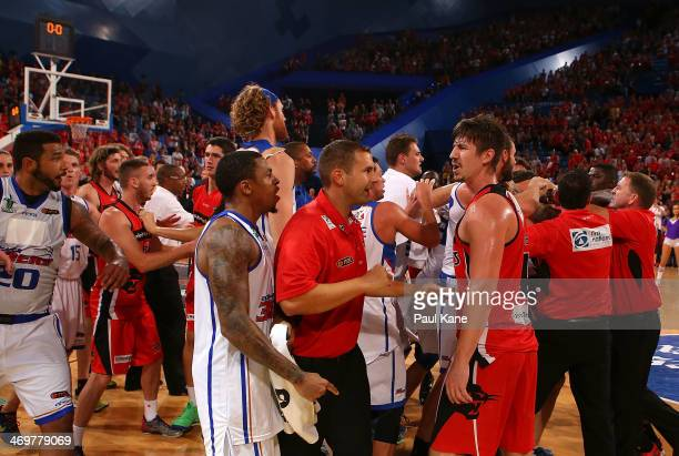 Gary Ervin of the 36ers and Greg Hire of the Wildcats exchange words as players and coaching staff from both sides remonstrate in a post game melee...