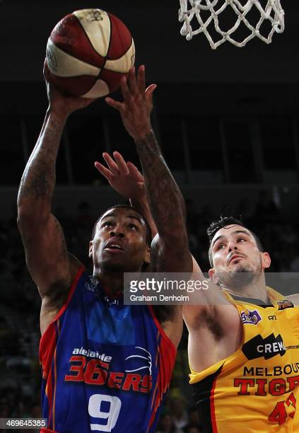 Gary Ervin of the 36ers drives at the basket under pressure from Chris Goulding of the Tigers during the round 18 NBL match between the Melbourne...