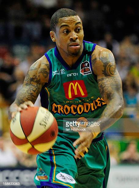 Gary Ervin of the Crocodiles dribbles the ball during the round 12 NBL match between the Townsville Crocodiles and the Adelaide 36ers at Townsville...