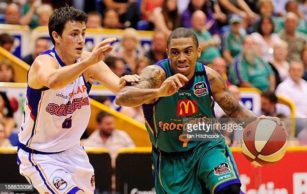 Gary Ervin of the Crocodiles drives to the basket past Tom Daly of the 36ers during the round 12 NBL match between the Townsville Crocodiles and the...
