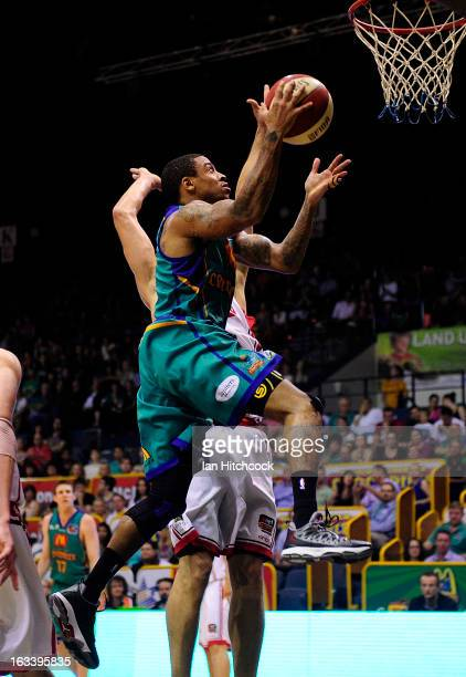 Gary Ervin of the Crocodiles jumps to make a basket during the round 22 NBL match between the Townsville Crocodiles and the Wollongong Hawks at...