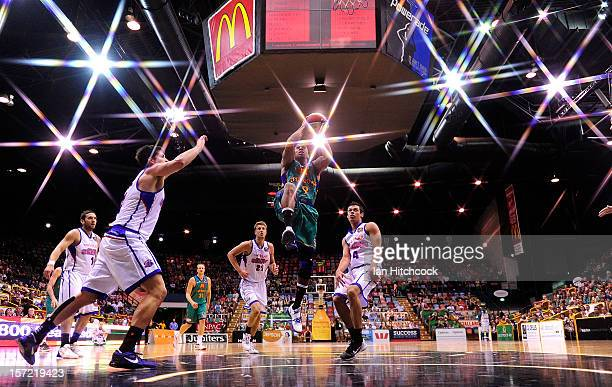 Gary Ervin of the Crocodiles makes a layup during the round nine NBL match between the Townsville Crocodiles and the Adelaide 36ers at Townsville...
