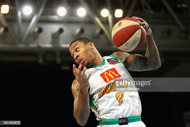 Gary Ervin of the Crocodiles makes a rebound during the round 24 NBL match between the Melbourne Tigers and the Townsville Crocodiles at Hisense...