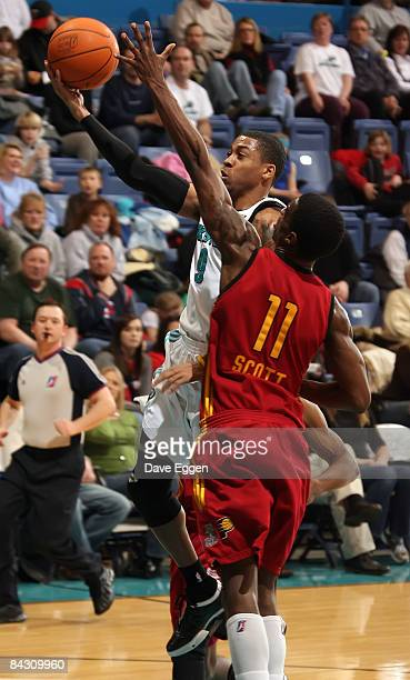 Gary Ervin of the Sioux Falls Skyforce takes the ball to the basket past Dewitt Scott of the Fort Wayne Mad Ants during their NBA D-League game at...
