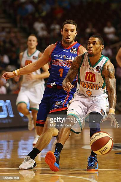 Gary Ervin of Townsville gets away from Adam Gibson of Adelaide during the round 11 NBL match between the Adelaide 36ers and the Townsville...