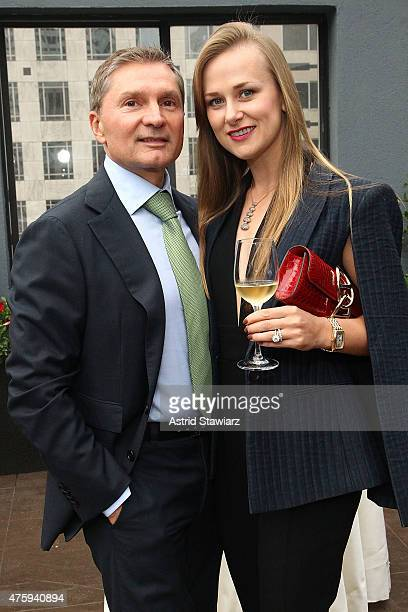 Gary Flom and Svetlana Flom pose for photos during the Roger Dubuis 20th Anniversary held at the Pennisula Hotel on June 4 2015 in New York City