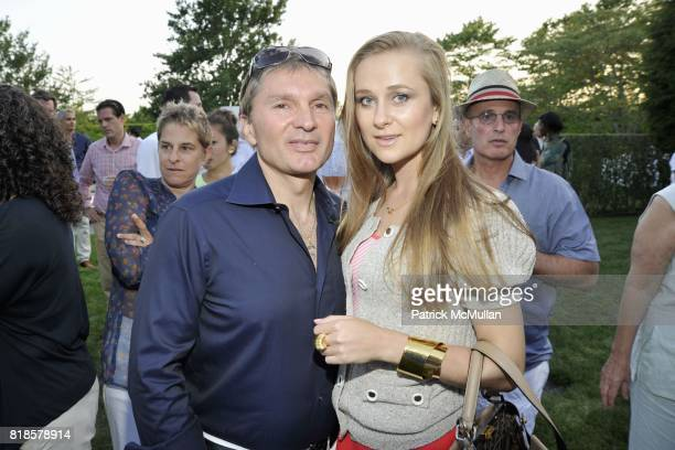 Gary Flom and Svitlana Chumakova attend GODS LOVE WE DELIVERMid Summer Night Drinks Benefit at Home of Chad A Leat on June 19 2010 in Bridgehampton...