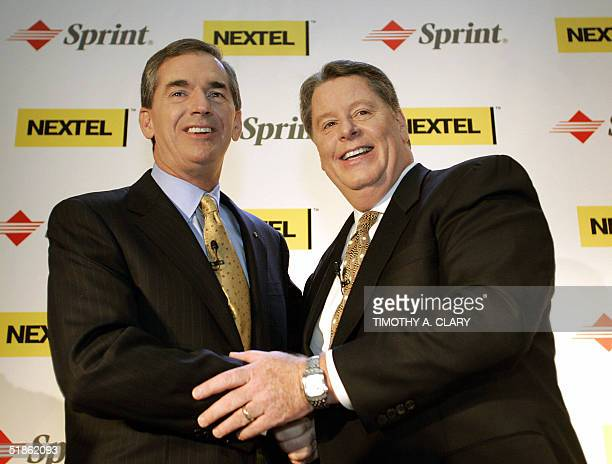 Gary Forsee Chairman and CEO of Sprint and Timothy Donahue President and CEO of Nextel shake hands before the start of a news conference in New York...