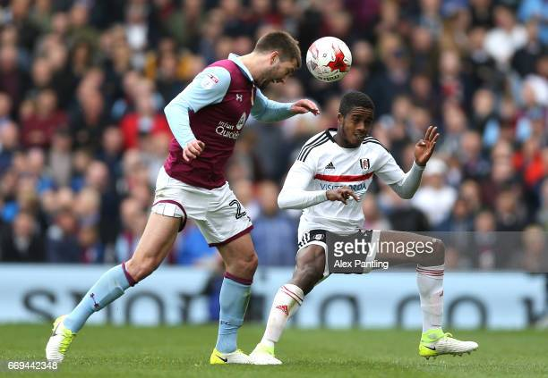 Gary Gardner of Aston Villa and Ryan Sessegnon of Fulham in action during the Sky Bet Championship match between Fulham and Aston Villa at Craven...