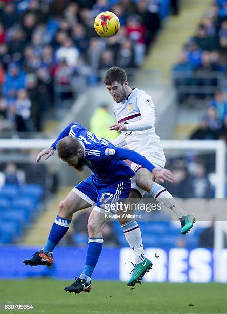 Gary Gardner of Aston Villa is challenged by Aron Gunnarsson of Cardiff City during the Sky Bet Championship match between Cardiff City and Aston...