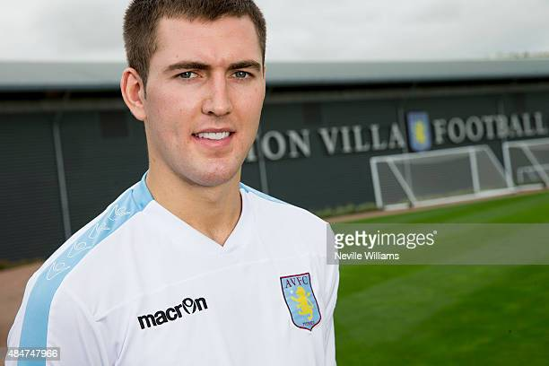 Gary Gardner of Aston Villa poses for a picture at the club's training ground after signing a new contract at Bodymoor Heath on August 21 2015 in...