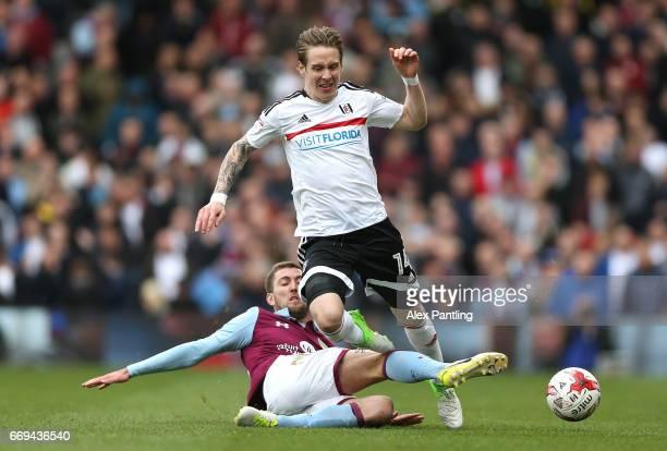 Gary Gardner of Aston Villa tackles Stefan Johansen of Fulham during the Sky Bet Championship match between Fulham and Aston Villa at Craven Cottage...