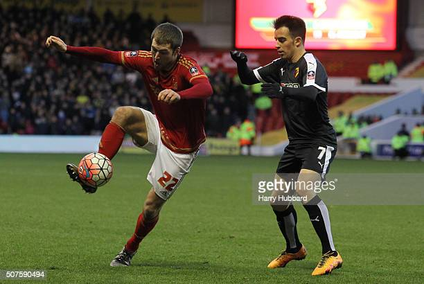 Gary Gardner of Nottingham Forest and Jose Manuel Jurado of Watford in action during the Emirates FA Cup Fourth Round match between Nottingham Forest...