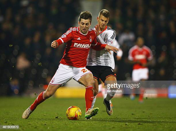 Gary Gardner of Nottingham Forest battles with Alex Kacaniklic of Fulham during the Sky Bet Championship match between Fulham and Nottingham Forest...