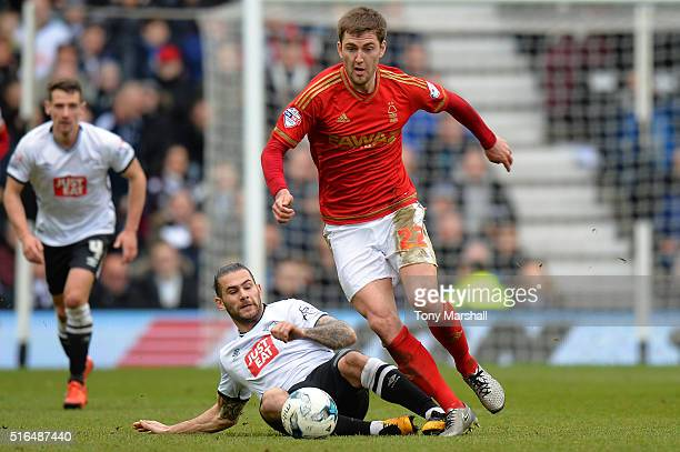 Gary Gardner of Nottingham Forest is tackled by Bradley Johnson of Derby County during the Sky Bet Championship match between Derby County and...