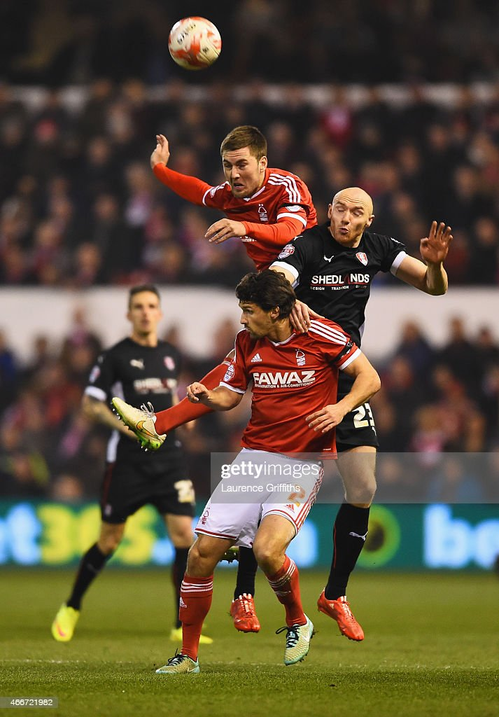 Gary Gardner of Nottingham Forest outjumps team mate Eric Lichaj (2) and Conor Sammon of Rotherham United (23) during the Sky Bet Championship match between Nottingham Forest and Rotherham United at City Ground on March 18, 2015 in Nottingham, England.