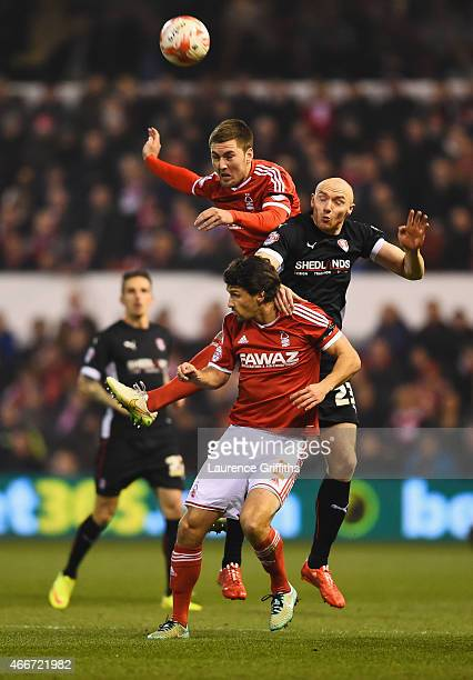 Gary Gardner of Nottingham Forest outjumps team mate Eric Lichaj and Conor Sammon of Rotherham United during the Sky Bet Championship match between...
