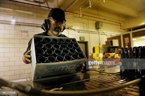 Gary Gassino loads the prelabeled bottles of Colorado Native Lager for filling at AC Golden Brewing Company in Golden Joe Amon The Denver Post