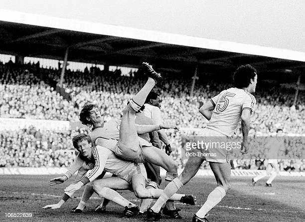 Gary Gillespie of Coventry City falls awkwardly onto Oxford United defender Mark Wright during their FA Cup 5th round match held at Highfield Road...
