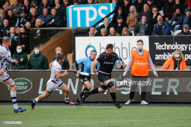 Gary Graham looks to hand-off Harry Randall of Bristol Bears during the Gallagher Premiership match between Newcastle Falcons and Bristol at Kingston...