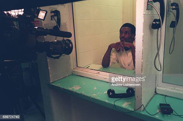 Gary Graham now Shaka Sankofa being interviewed by a TV crew in the visitor's room of the Terrell Unite Where Texas' death row is located
