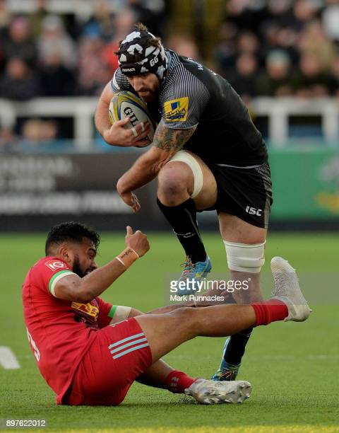 Gary Graham of Newcastle Falcons is tackled by Alofa Alofa of Harlequins during the Aviva Premiership match between Newcastle Falcons and Harlequins...