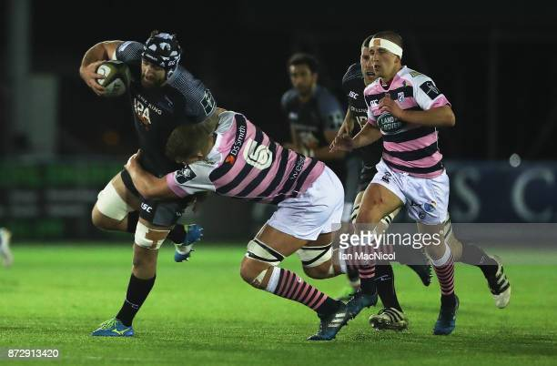 Gary Graham of Newcastle Falcons is tackled by Shane LewisHughes of Cardiff Blues during the AngloWelsh Cup match between Newcastle Falcons and...