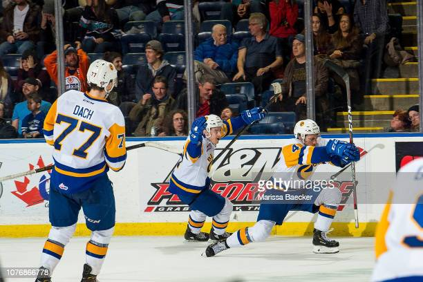 Gary Haden and Dawson Davidson of the Saskatoon Blades celebrate the overtime winning goal against the Kelowna Rockets at Prospera Place on December...
