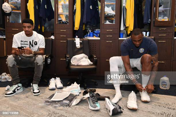 Gary Harris and Darrell Arthur of the Denver Nuggets get ready before the game against the Detroit Pistons on March 15 2018 at the Pepsi Center in...