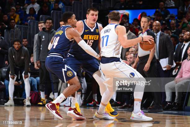 Gary Harris and Nikola Jokic of the Denver Nuggets guard Luka Doncic of the Dallas Mavericks on October 29, 2019 at the Pepsi Center in Denver,...