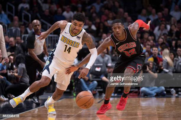 Gary Harris of the Denver Nuggets and Kris Dunn of the Chicago Bulls battle for the basketball at Pepsi Center on November 30 2017 in Denver Colorado...