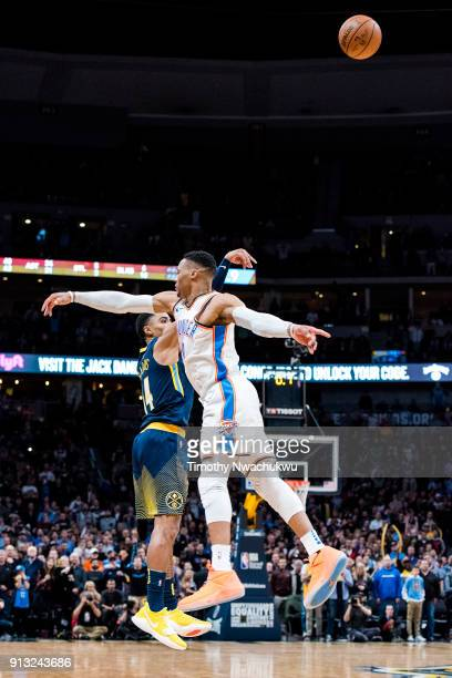 Gary Harris of the Denver Nuggets attempts the gamewinning three point basket over Russell Westbrook of the Oklahoma City Thunder at Pepsi Center on...