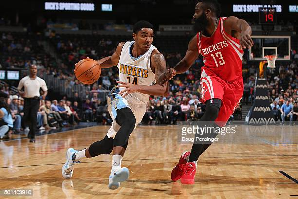 Gary Harris of the Denver Nuggets controls the ball against James Harden of the Houston Rockets at Pepsi Center on December 14 2015 in Denver...