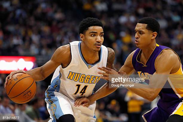 Gary Harris of the Denver Nuggets controls the ball against Jordan Clarkson of the Los Angeles Lakers at Pepsi Center on March 2 2016 in Denver...