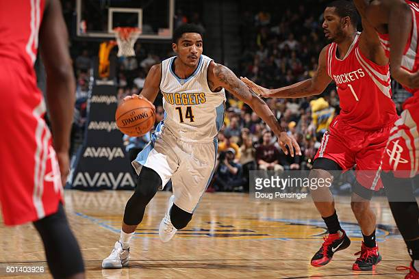 Gary Harris of the Denver Nuggets controls the ball against Trevor Ariza of the Houston Rockets at Pepsi Center on December 14 2015 in Denver...