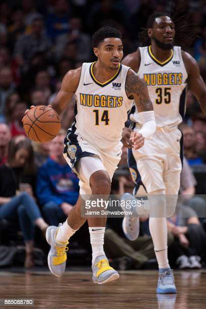 Gary Harris of the Denver Nuggets dribbles down court against the Chicago Bulls at Pepsi Center on November 30 2017 in Denver Colorado