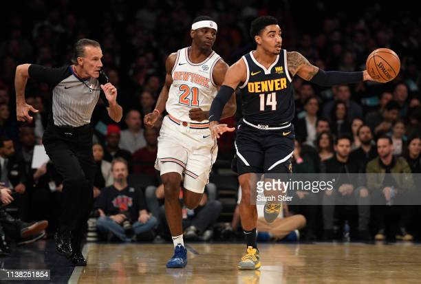 Gary Harris of the Denver Nuggets dribbles the ball against Damyean Dotson of the New York Knicks during the first half of the game at Madison Square...