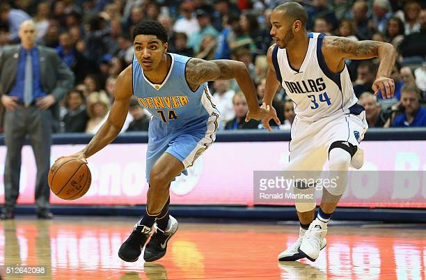 Gary Harris of the Denver Nuggets dribbles the ball against Devin Harris of the Dallas Mavericks during the first half at American Airlines Center on...