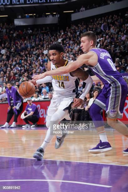 Gary Harris of the Denver Nuggets drives against Bogdan Bogdanovic of the Sacramento Kings on January 6 2018 at Golden 1 Center in Sacramento...