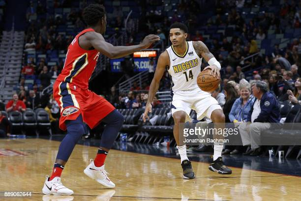Gary Harris of the Denver Nuggets drives against Jrue Holiday of the New Orleans Pelicans during the second half of a game at the Smoothie King...