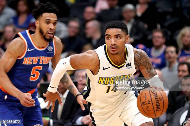 Gary Harris of the Denver Nuggets drives past Courtney Lee of the New York Knicks at the Pepsi Center on January 25 2018 in Denver Colorado NOTE TO...