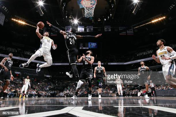 Gary Harris of the Denver Nuggets drives to the basket against the Brooklyn Nets on October 29 2017 at Barclays Center in Brooklyn New York NOTE TO...