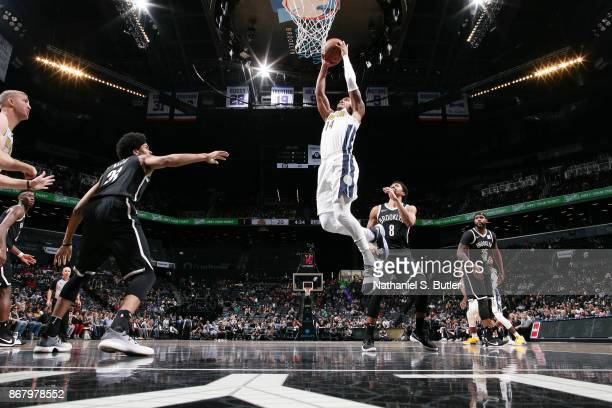 Gary Harris of the Denver Nuggets drives to the basket against the Brooklyn Nets on October 29, 2017 at Barclays Center in Brooklyn, New York. NOTE...