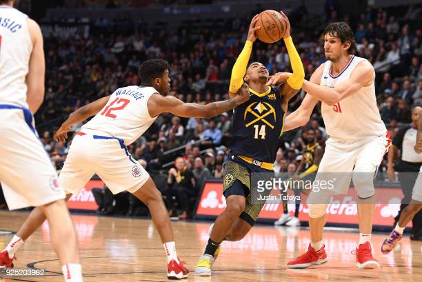 Gary Harris of the Denver Nuggets drives to the basket against Tyrone Wallace and Boban Marjanovic of the LA Clippers at Pepsi Center on February 27...
