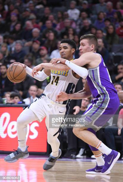 Gary Harris of the Denver Nuggets drives to the basket on Bogdan Bogdanovic of the Sacramento Kings during an NBA Basketball game at Golden 1 Center...