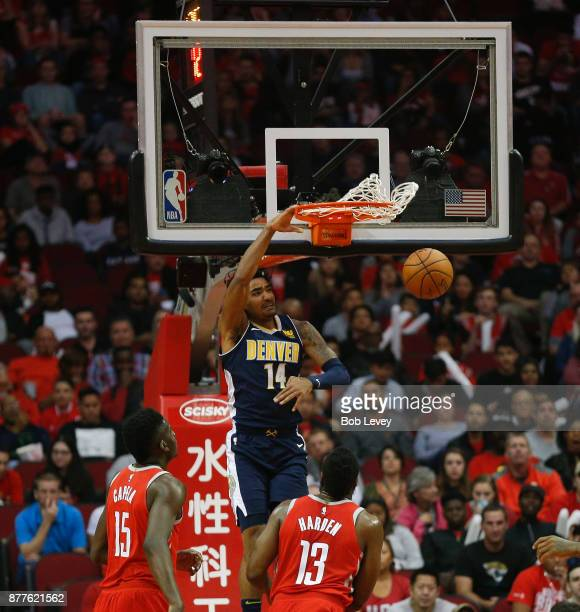 Gary Harris of the Denver Nuggets dunks over Clint Capela of the Houston Rockets and James Harden in the firt quarter at Toyota Center on November 22...