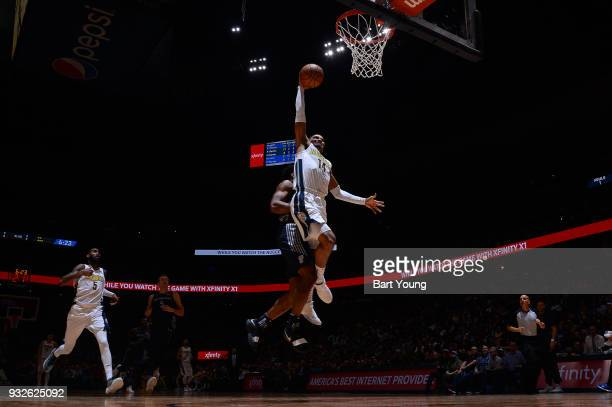 Gary Harris of the Denver Nuggets dunks the ball against the Detroit Pistons on March 15 2018 at the Pepsi Center in Denver Colorado NOTE TO USER...